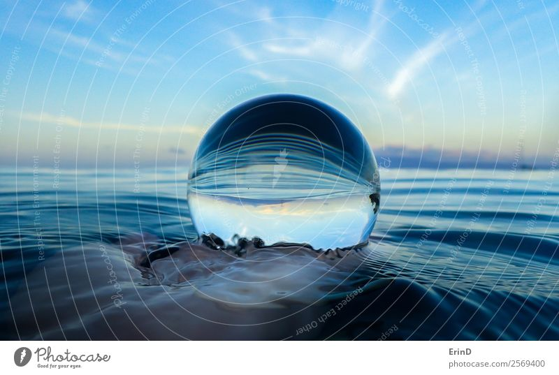 Ocean Surface Ripples Close up in Glass Ball Calm Vacation & Travel Waves Hand Environment Nature Landscape Sky Virgin forest Sphere Wet Blue Serene Peace water