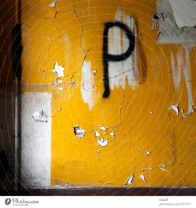 public Interior design Decoration Wall (barrier) Wall (building) Stone Concrete Sign Characters Old Esthetic Authentic Dirty Simple Original Rebellious Yellow