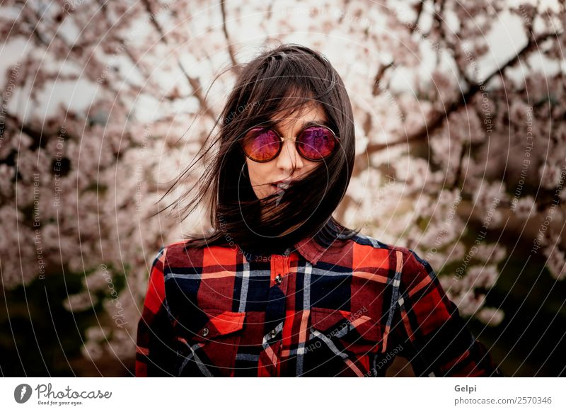 Girl Style Happy Beautiful Face Garden Human being Woman Adults Nature Wind Tree Flower Blossom Park Fashion Sunglasses Brunette Smiling Happiness Fresh Natural