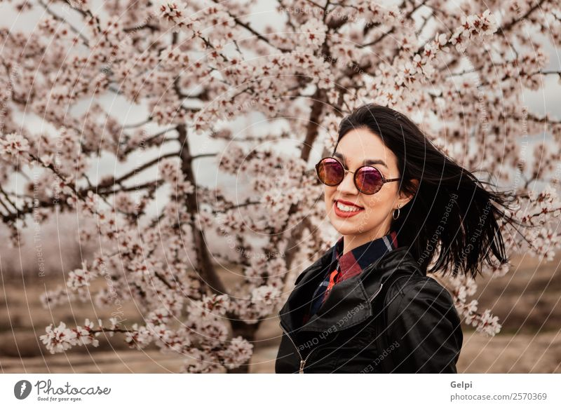 Girl Style Happy Beautiful Face Garden Human being Woman Adults Nature Tree Flower Blossom Park Fashion Jacket Leather Sunglasses Brunette Smiling Happiness