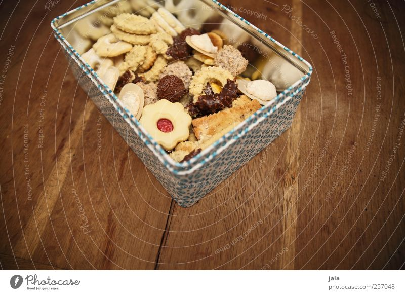 hip gold Food Dough Baked goods Candy Cookie Christmas biscuit Nutrition Finger food Tin Delicious Sweet Wooden table Colour photo Interior shot Deserted