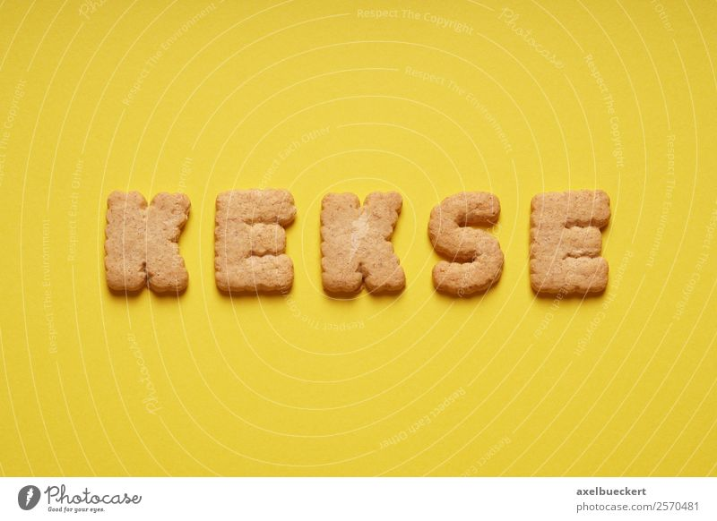 biscuits Food Dough Baked goods Candy Nutrition To have a coffee Yellow Cookie Letters (alphabet) Word Text Bird's-eye view Colour photo Studio shot Deserted
