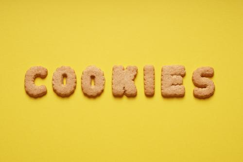Cookies Yellow Food Letters (alphabet) Candy Baked goods Word Text Dough English To have a coffee