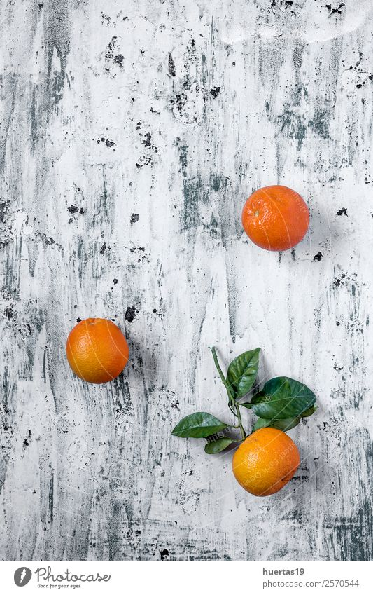 Oranges on light backgroundwith Green Food Natural Copy Space Fruit Nutrition Fresh Delicious Beverage Drinking Breakfast Diet Vegetarian diet Refreshment