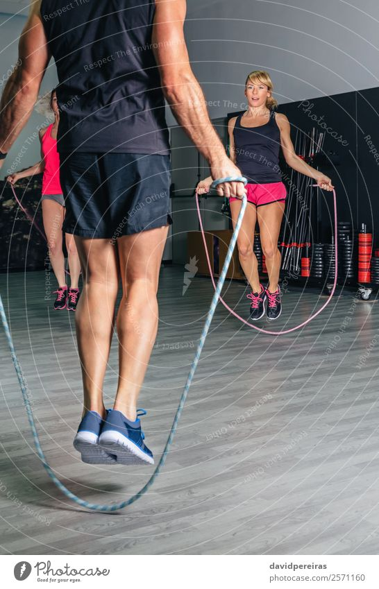Trainer teaching exercises with jumping ropes to women Happy Body Sports School Rope Woman Adults Man Arm Group Fitness Skipping Jump Authentic Strong Power