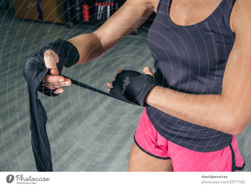 Woman wrapping hands with bandages before boxing training Beautiful Body Sports Human being Adults Hand Gloves Fitness Authentic Eroticism Muscular Strong Power