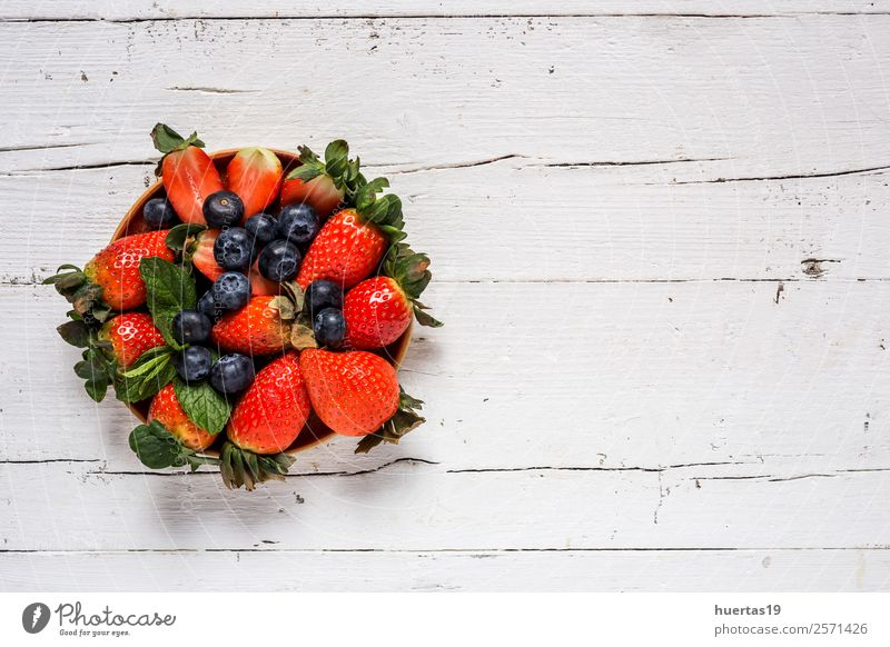Mix of strawberries and blueberries Old Green Red Leaf Food Natural Copy Space Group Above Fruit Nutrition Fresh Table Delicious Dessert Breakfast