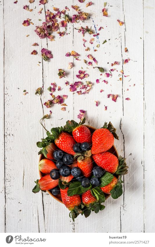 Mix of strawberries and blueberries Food Vegetable Fruit Dessert Candy Nutrition Breakfast Dinner Vegetarian diet Diet Table Group Leaf Old Fresh Delicious