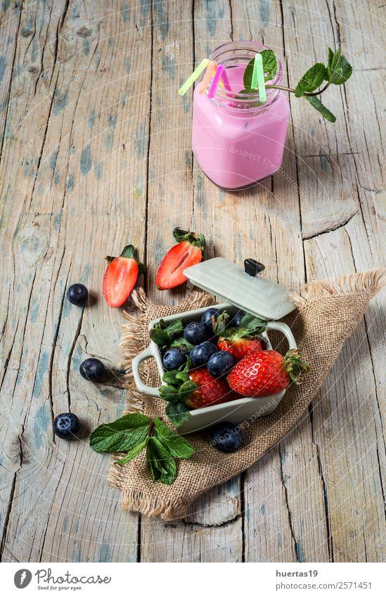 smoothie to Mix of strawberries and blueberries Food Vegetable Fruit Dessert Candy Nutrition Breakfast Dinner Vegetarian diet Diet Beverage Table Group Leaf Old