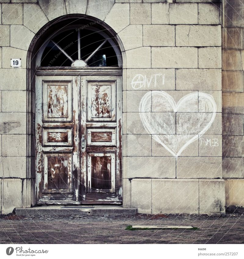 The last door Living or residing House (Residential Structure) Wall (barrier) Wall (building) Facade Door Graffiti Heart Old Authentic Brown Gray Mysterious