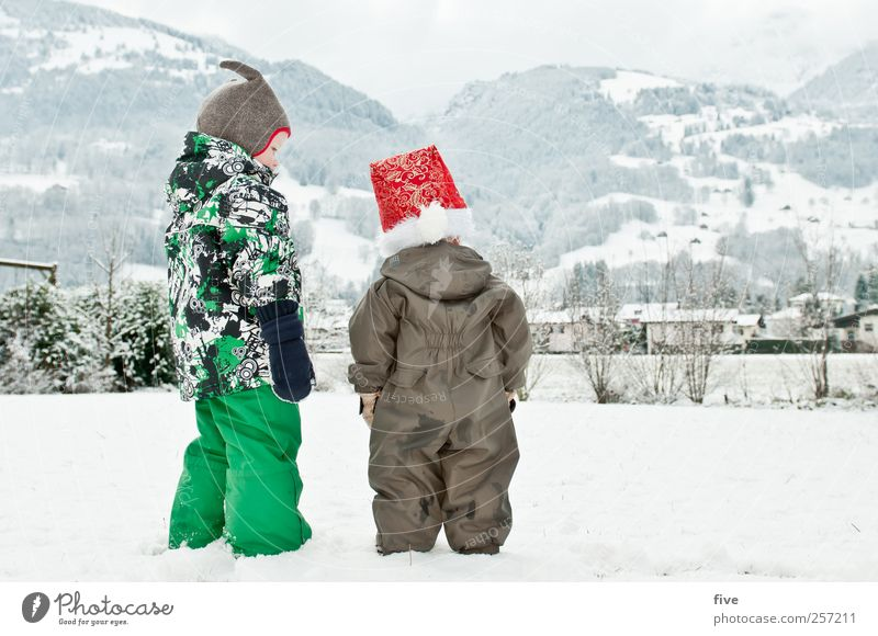 Human being Child Sky Christmas & Advent Nature Girl Winter Clouds Meadow Snow Environment Landscape Emotions Mountain Boy (child) Family & Relations