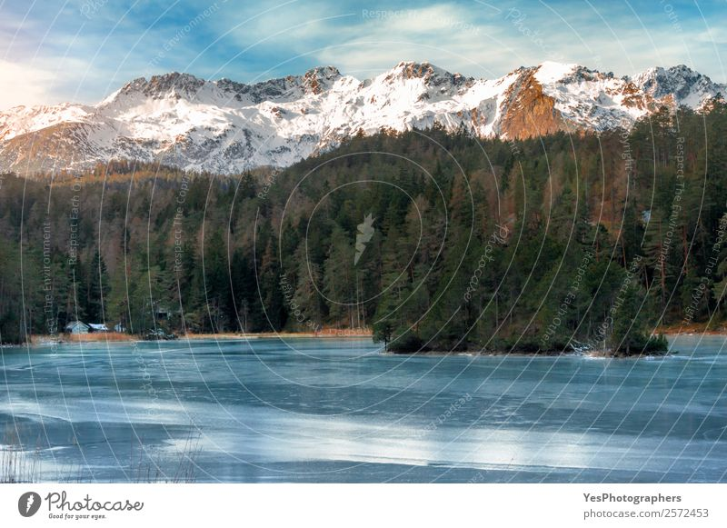 Frozen lake and snow-capped mountains Nature Vacation & Travel Blue Landscape Forest Winter Mountain Snow Tourism Lake Rock Free Ice Europe Beautiful weather