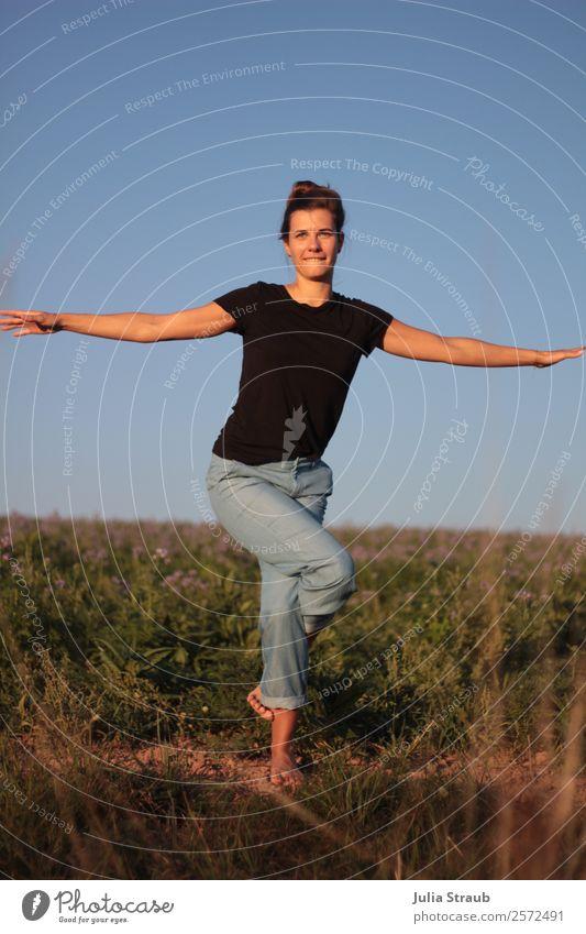Pretty woman doing yoga practice on a field Yoga Feminine Woman Adults 1 Human being 30 - 45 years Sunlight Summer Beautiful weather flowers Grass Meadow Field
