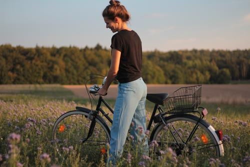bicycle field forest woman Cycling Bicycle Feminine Woman Adults 1 Human being 30 - 45 years Sky Summer Beautiful weather Flower Grass Lavender field phazelie