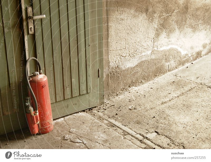 fir tree ... Concrete Wood Dirty Broken Gloomy Green Red Car door Extinguisher Fire prevention Safety Threat Blaze dilapidated Wall (building) Colour photo