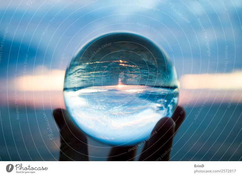 Sunset Seascape Captured in Glass Ball Sky Nature Vacation & Travel Beautiful Colour Landscape Hand Ocean Clouds Environment Small Watercraft Bright Horizon