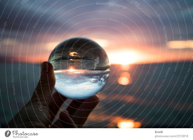 Sunset over Ocean Captured in Glass Ball Beautiful Vacation & Travel Hand Environment Nature Landscape Sky Clouds Horizon Watercraft Sphere Globe Bright Small