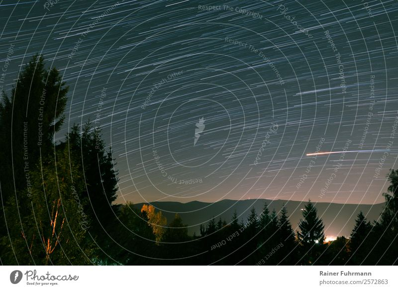 "a startrail over the mountains of the Giant Mountains Environment Nature Landscape Sky Night sky Stars Park Dark ""Startrail Starry sky Mars Colour photo"