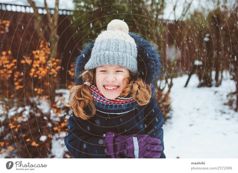winter lifestyle portrait of happy kid girl playing Child Nature Vacation & Travel Joy Winter Lifestyle Warmth Snow Laughter Garden Playing Park Weather Smiling