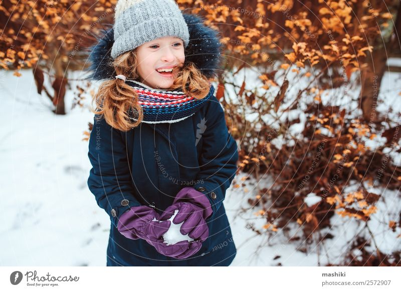 winter portrait of happy kid girl playing snowballs Lifestyle Joy Playing Vacation & Travel Winter Snow Garden Child Nature Weather Warmth Park Clothing Gloves