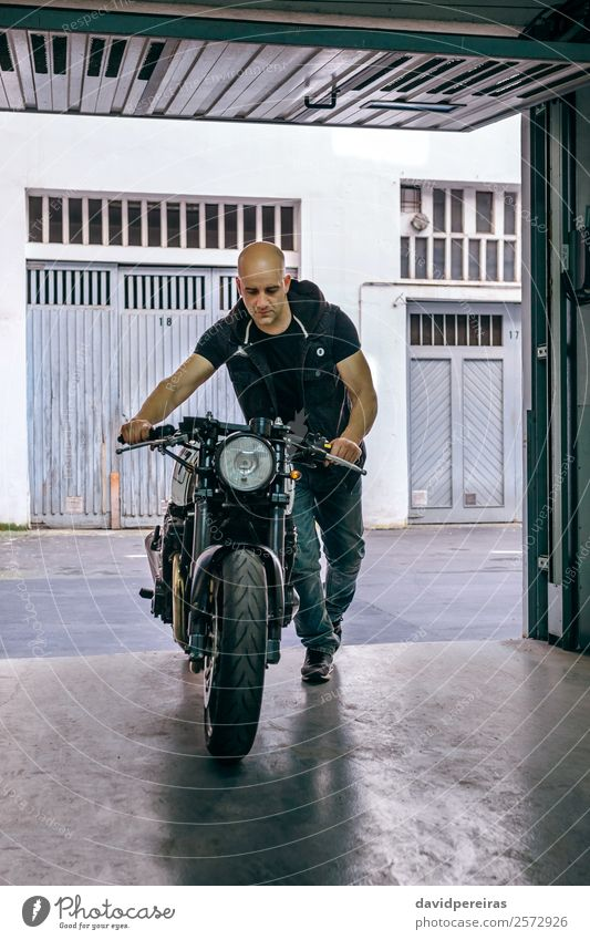 Biker taking motorbike to the garage Human being Vacation & Travel Man Street Lifestyle Adults Style Trip Transport Retro Open Stand Authentic Jeans Vehicle