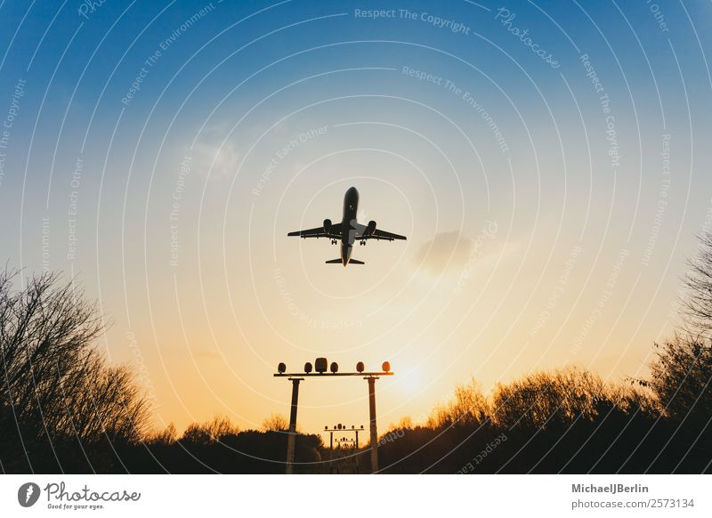 Airplane over signal systems in approach on airport Vacation & Travel Dark International Sunset Logistics Transport Airplane landing Airport Back-light Safety