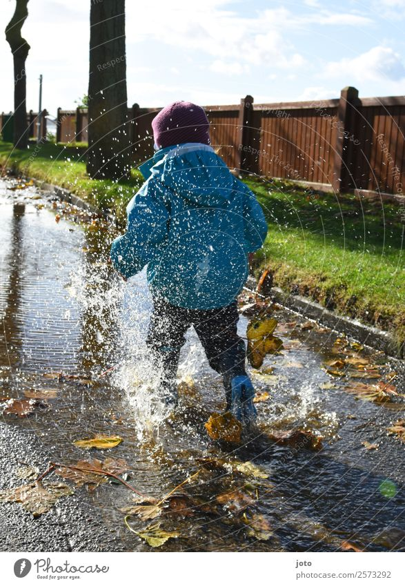 autumn day Trip Child Toddler 1 Human being 1 - 3 years Autumn Protective clothing Rubber boots Movement Walking Running Free Athletic Joy