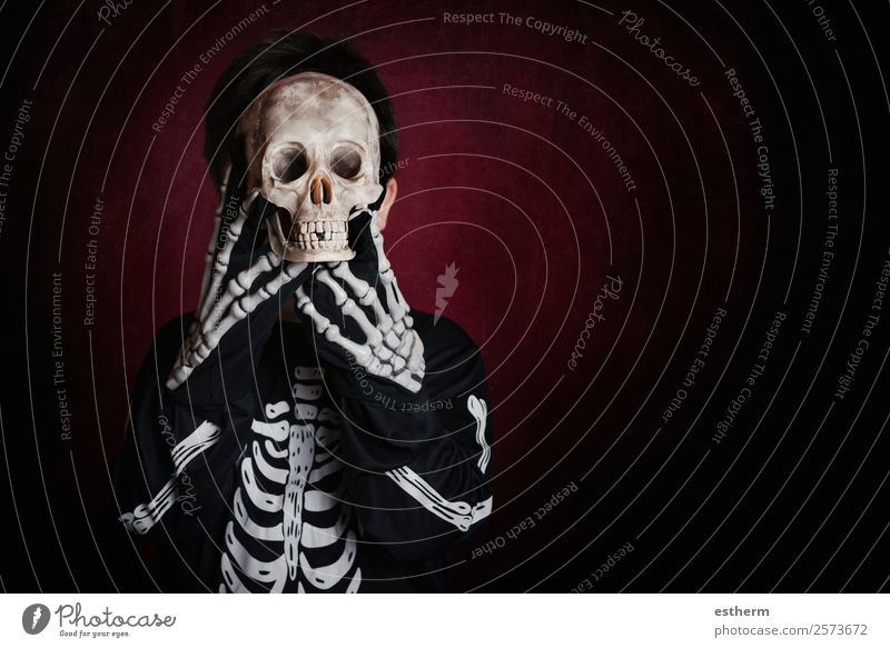 boy in skeleton costume on halloween Child Human being Joy Dark Lifestyle Autumn Movement Feasts & Celebrations Party Death Fear Masculine Infancy Smiling