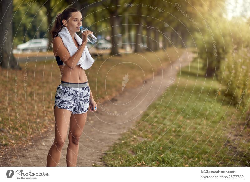 Fit sporty woman drinking water from a bottle Bottle Sports Woman Adults 1 Human being 18 - 30 years Youth (Young adults) Park Fitness Athletic training young