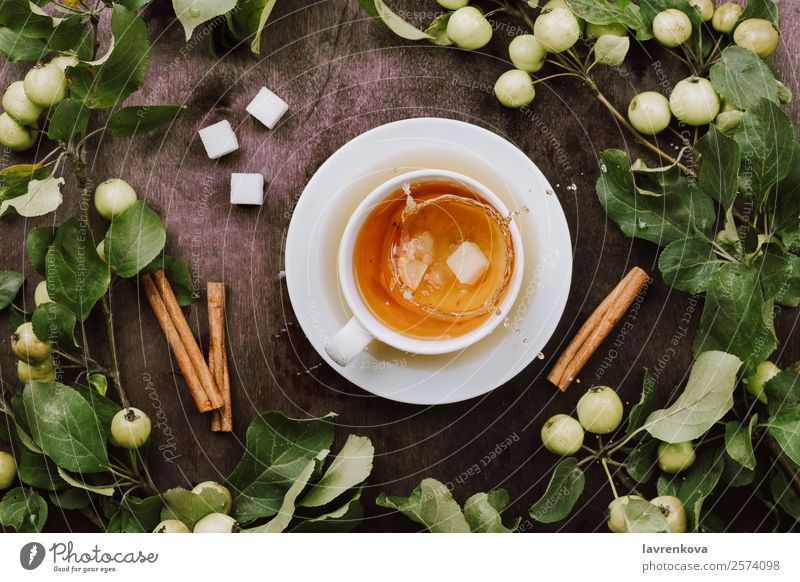 Flatlay with cup of warm tea, apple tree branches Splash Cozy Warmth Beverage Lump sugar Harvest Mature Apple Branch Cinnamon Natural Healthy Eating Fresh