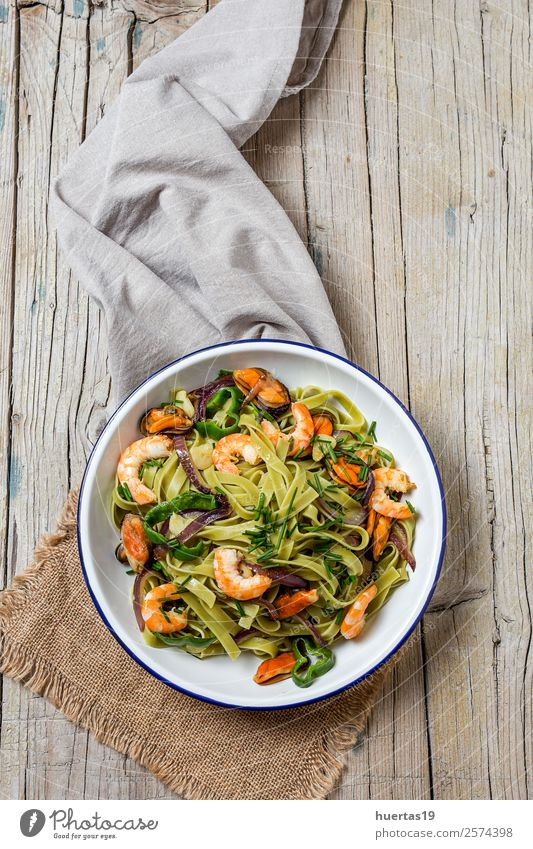 Green tagliatelle with seafood Food Seafood Vegetable Bread Italian Food Plate Fork Style Design Table Gastronomy Mussel Fresh Healthy Delicious Above