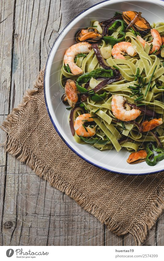 Green tagliatelle with seafood. Food Seafood Vegetable Bread Herbs and spices Italian Food Plate Fork Healthy Eating Table Gastronomy Mussel Delicious