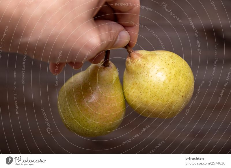 Delicious pears Food Fruit Organic produce Vegetarian diet Healthy Eating Kitchen Man Adults Hand Fingers Work and employment Select To hold on Fresh Pear