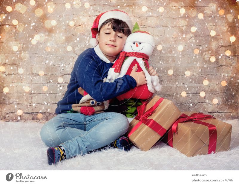 Happy child on Christmas eve Child Human being Christmas & Advent Joy Winter Lifestyle Emotions Feasts & Celebrations Think Masculine Dream Infancy Smiling