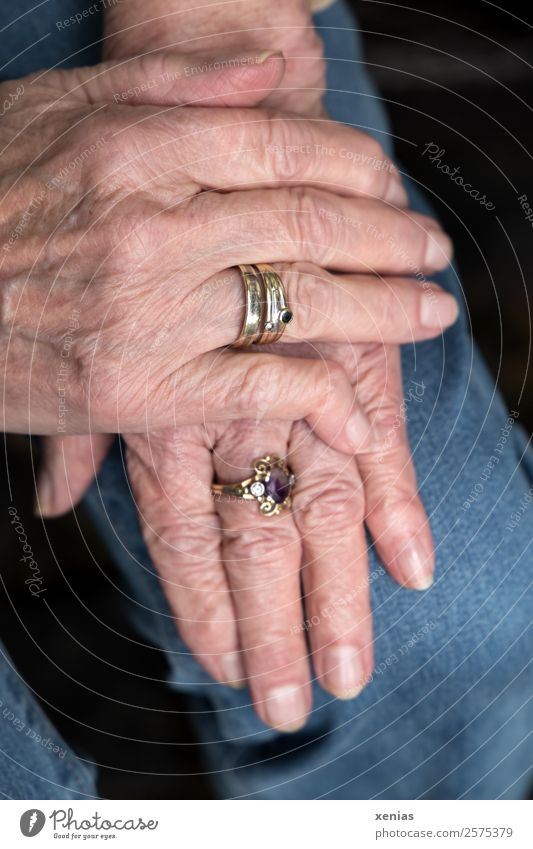 Mature hands with rings of a lady lying on her knee Woman Adults Female senior Senior citizen Hand Fingers 60 years and older Jeans Jewellery Ring Old Groomed