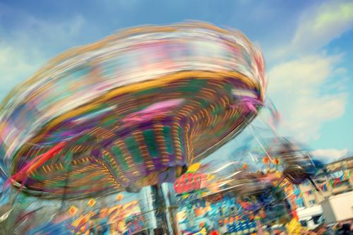 Colourful, rotating chain carousel at a fair Joy Leisure and hobbies Feasts & Celebrations Oktoberfest Fairs & Carnivals Rotate To swing Happiness Multicoloured