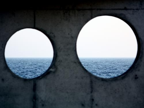Two Holes Reminding Nature Elements Sky Waves Baltic Sea Ocean Sea water Blue Gray White Horizon Uniqueness Inspiration Calm Whimsical Concrete Concrete wall