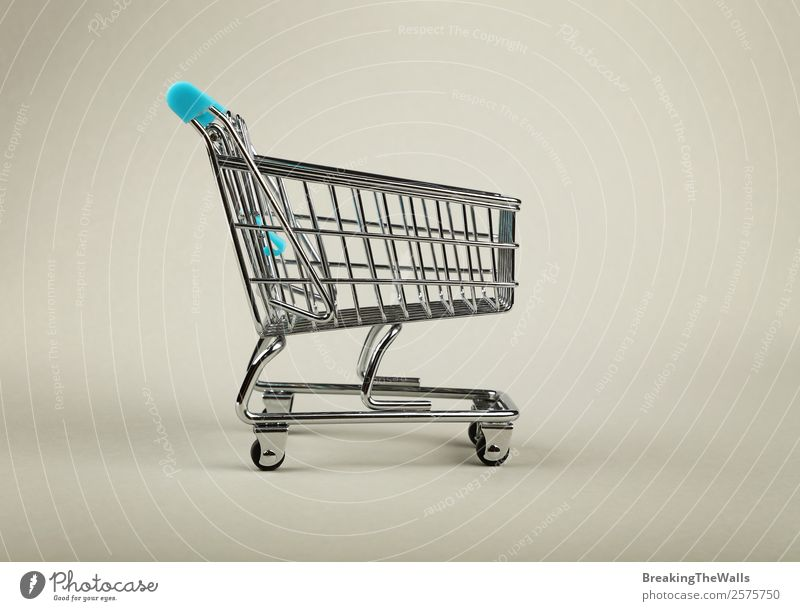 Close up empty supermarket shopping cart over grey Shopping Economy Industry Trade Logistics Business Toys Metal Modern Gray Retail sector trolley Supermarket