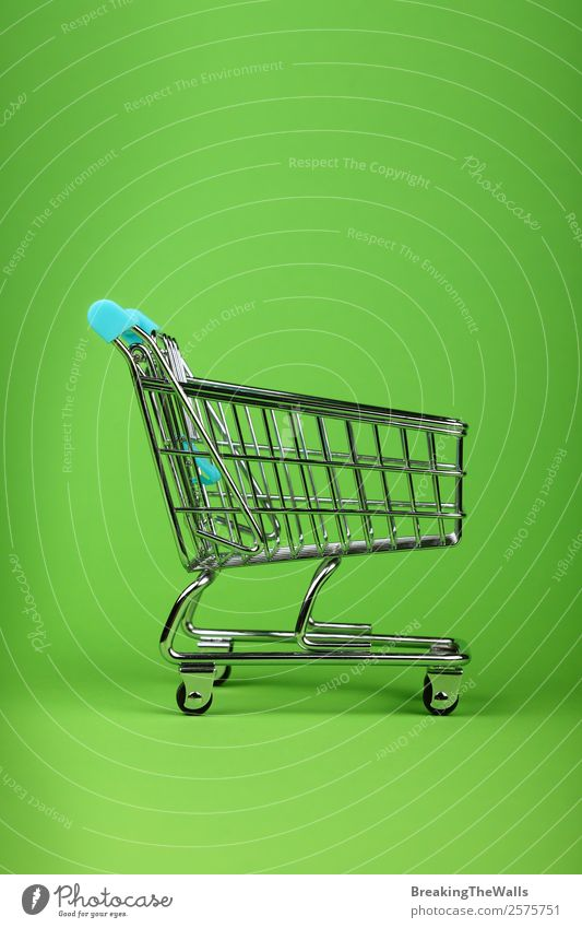 Close up empty toy metal supermarket shopping cart Shopping Children's game Economy Logistics Business Toys Metal Plastic Green Colour Trade Retail sector Side
