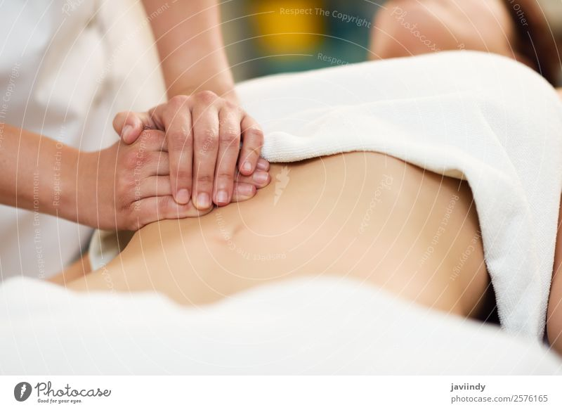 Woman receiving abdomen massage at spa salon. Human being Youth (Young adults) Young woman Beautiful Hand Relaxation Lifestyle Adults Work and employment Body