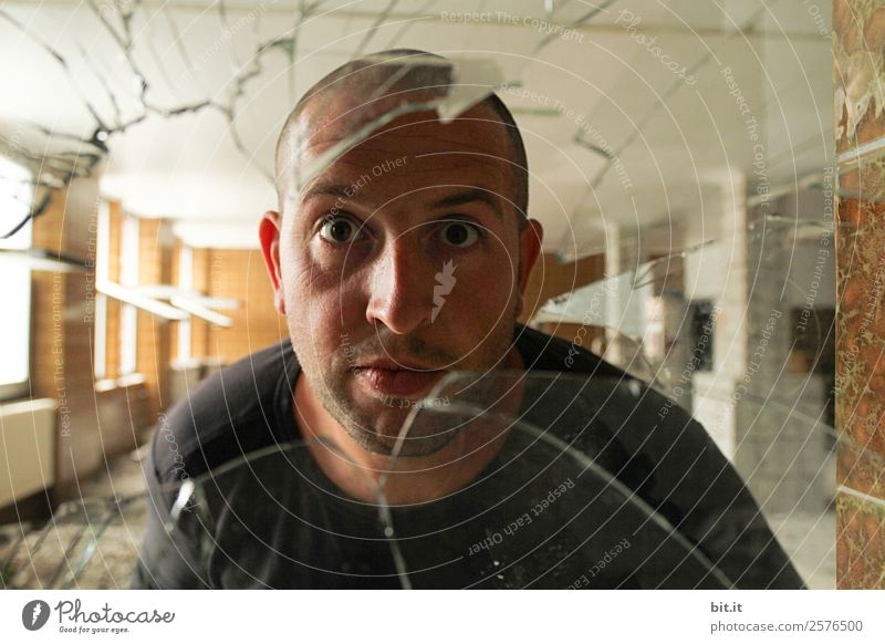 Man looks through old, broken glass pane. School Craftsperson Workplace Masculine Young man Youth (Young adults) Adults Glass Fiasco Adversity Curiosity Protest