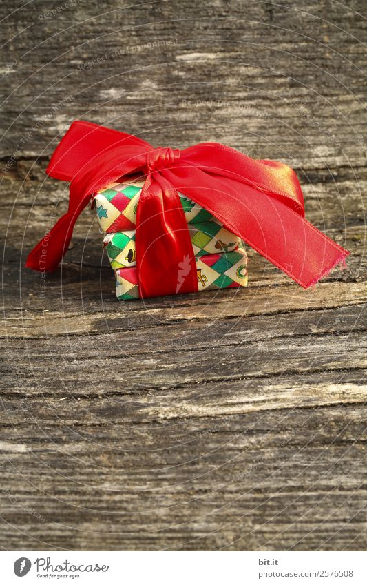 Christmas parcel with red bow on wooden background. Living or residing Feasts & Celebrations Christmas & Advent Birthday Decoration Brown Multicoloured Red