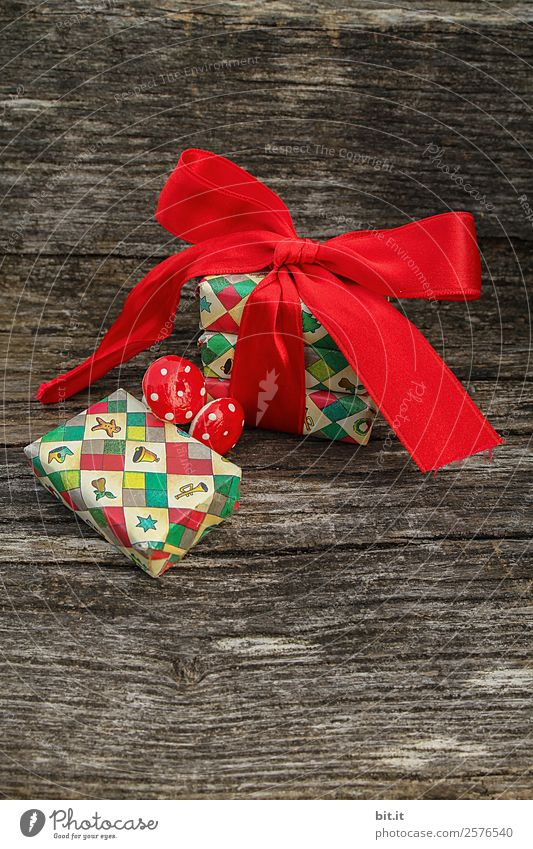 Christmas parcel with red bow on wooden background. Feasts & Celebrations Christmas & Advent Brown Multicoloured Red Christmas decoration Christmas gift