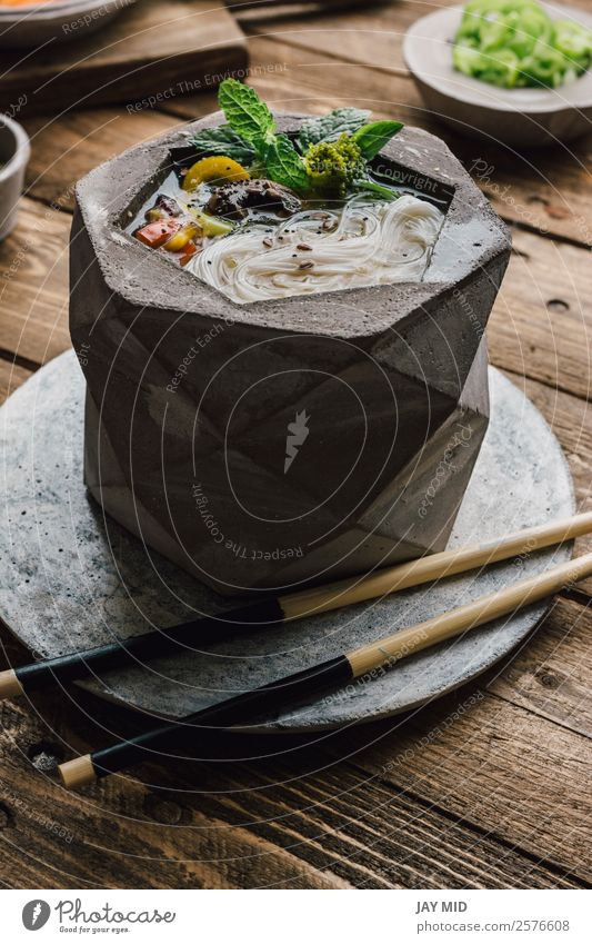 Geometric bowl of Asian Noodle Soup with chopsticks Food Meat Vegetable Dough Baked goods Stew Lunch Dinner Asian Food Bowl Lifestyle Table Wood Fresh Delicious