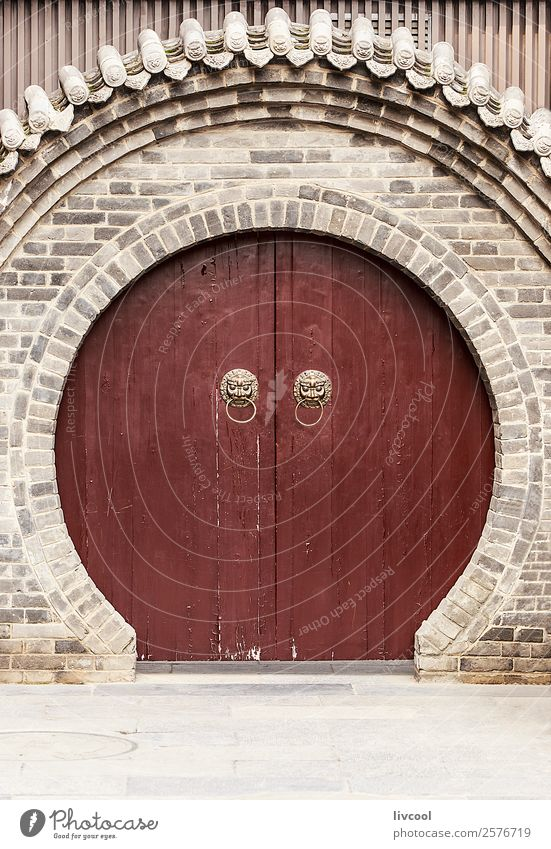 circular china door, chinese wall in xian Face Art Animal Town Places Building Architecture Door Monument Street Wood Historic Brown Gray Religion and faith