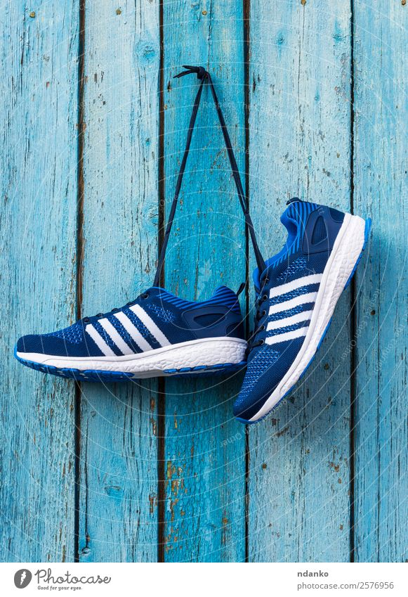 male blue textile sneakers Lifestyle Sports Fashion Clothing Footwear Sneakers Wood Old Fitness Hang Blue background pair nail Gymnasium running wall Hanging