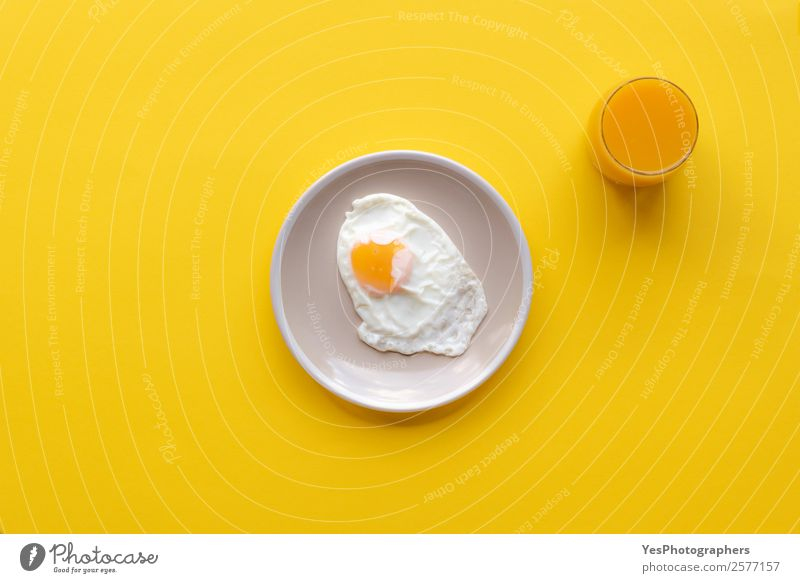 Fried egg and orrange juice Healthy Yellow Food Copy Space Bright Nutrition Fresh Cooking Delicious Beverage Good Breakfast Diet Plate Meal