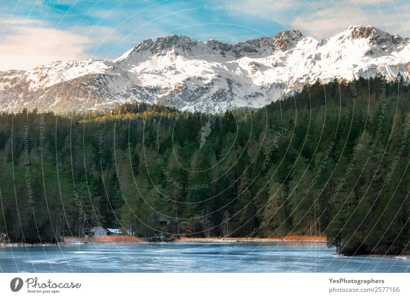Snow-capped mountains and frozen lake Tourism Winter Winter vacation Mountain Nature Landscape Weather Beautiful weather Ice Frost Rock Alps Peak