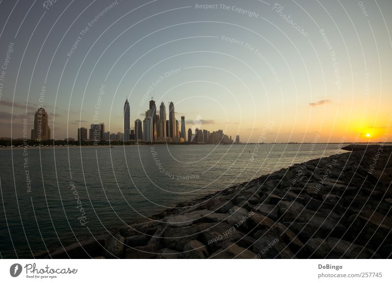 A New Year's greeting Vacation & Travel Sun Water Clouds Sunrise Sunset Sunlight Coast Town Skyline High-rise Building Architecture Yellow Gold 2011 Arabia