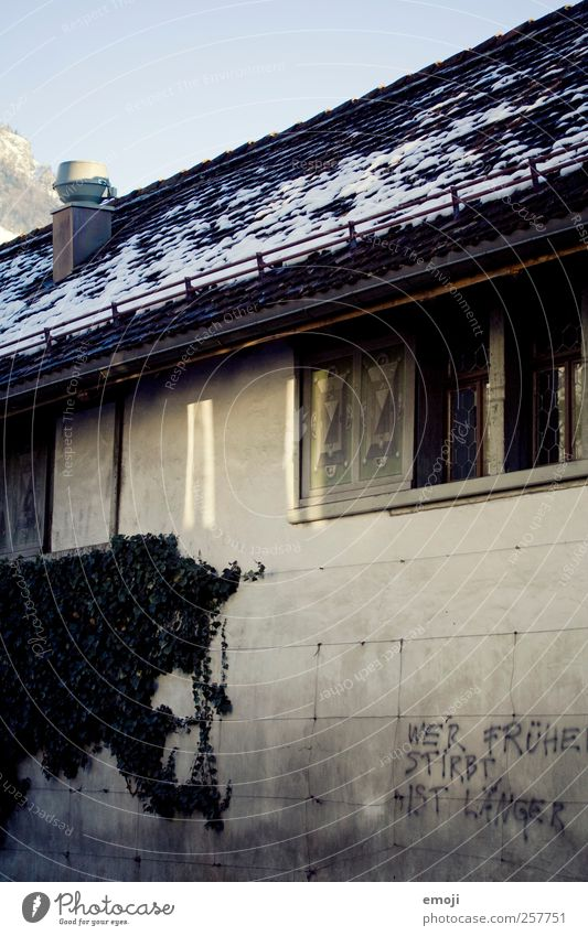 Those who die earlier are longer House (Residential Structure) Building Wall (barrier) Wall (building) Facade Window Roof Threat Dark Gray Graffiti